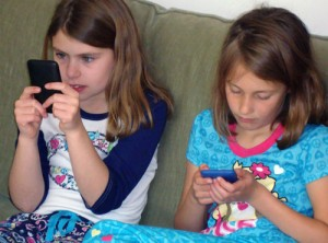 Kids using iPods